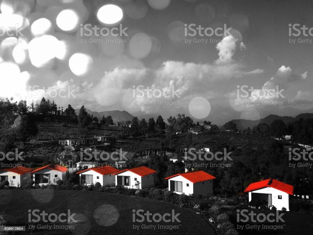 orange cottage landsape in color pop with bokeh stock photo