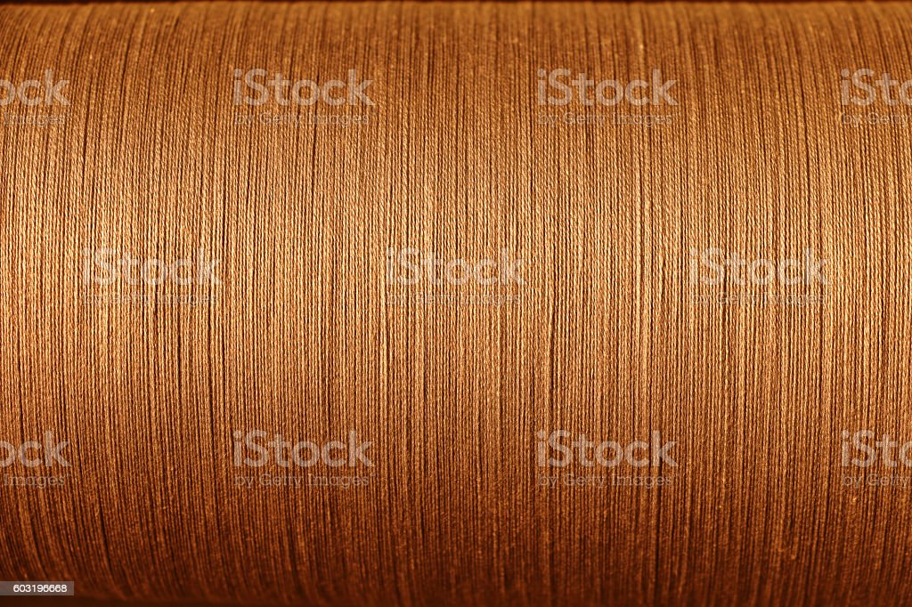 orange cotton thread from weaving machine, Abstract background stock photo