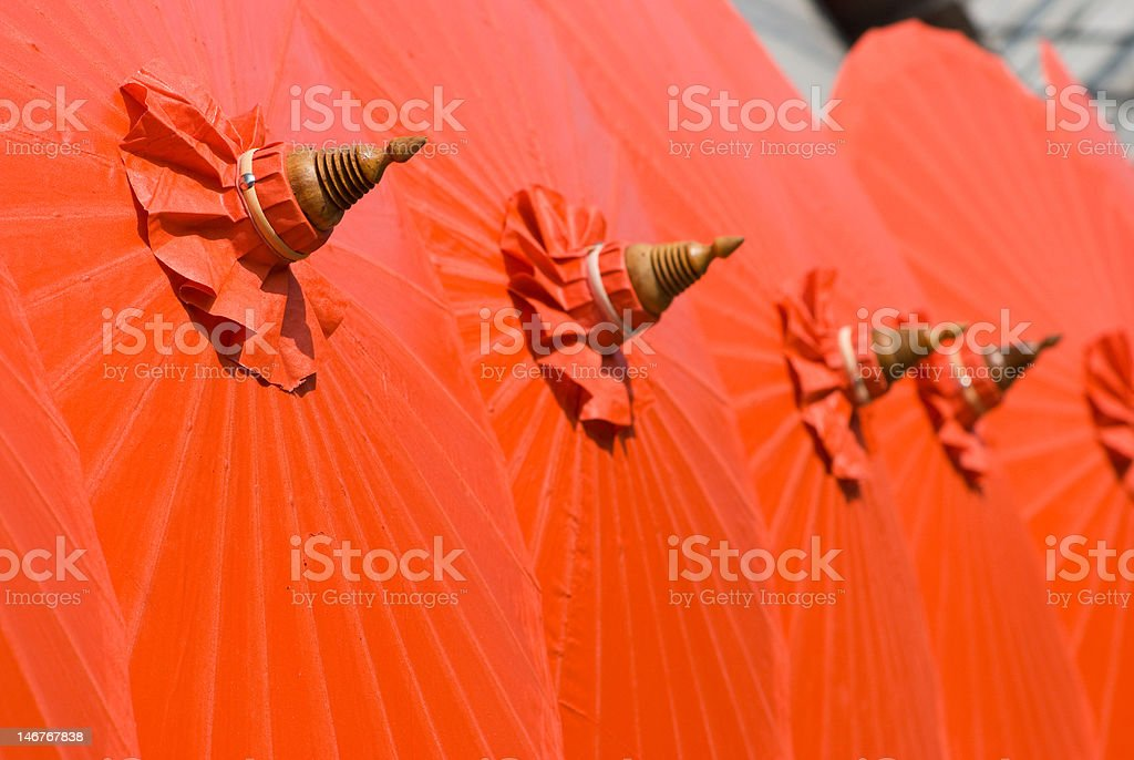 Orange cotton umbrellas in Thailand stock photo