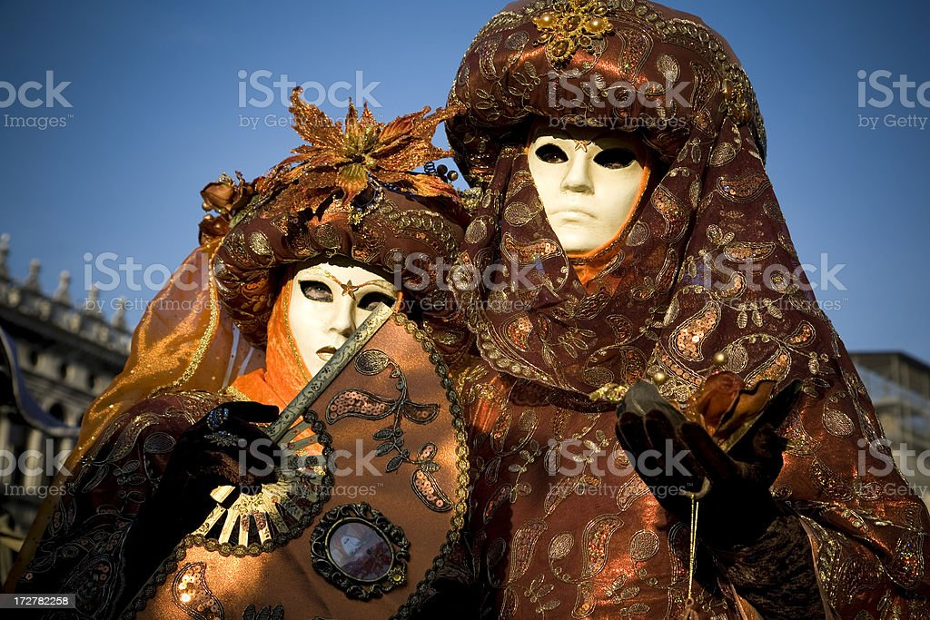 Orange Couple; Carnival in Venice 2008 royalty-free stock photo