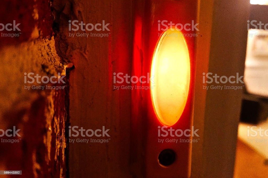 Orange Door bell stock photo