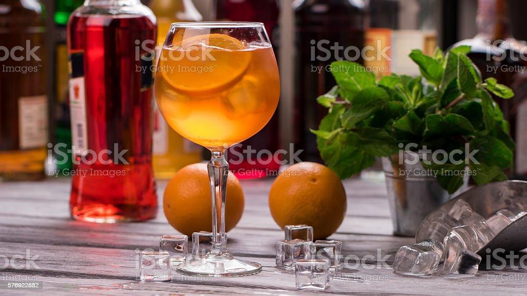 Orange drink in wineglass. stock photo