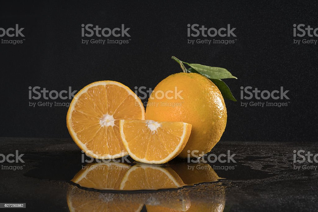 orange duo with Leafs black background. stock photo
