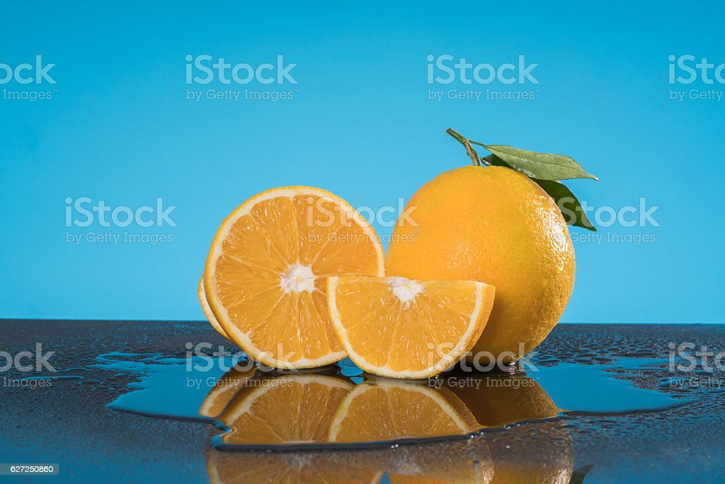 orange duo with Leafs blue background stock photo