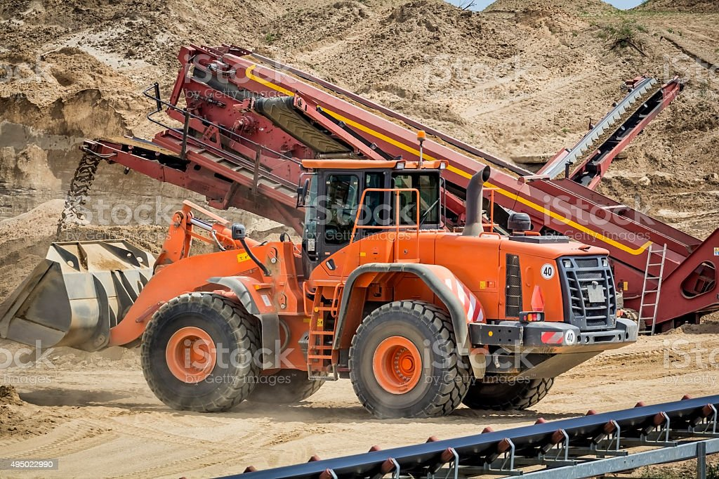 Orange earth mover in Sand Quarry stock photo