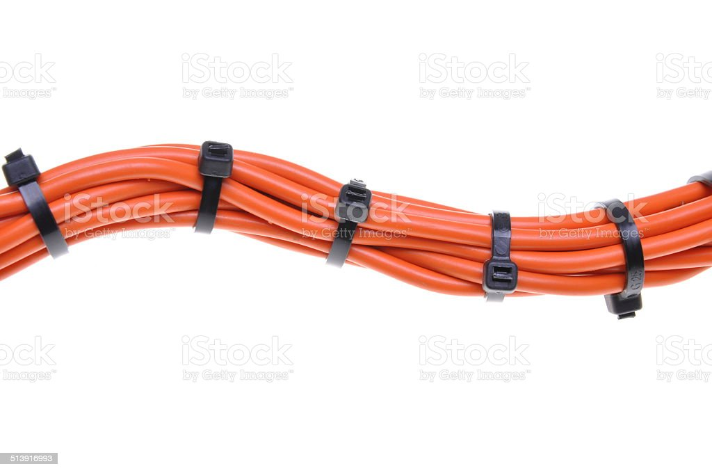 Orange electrical cables with cable ties stock photo