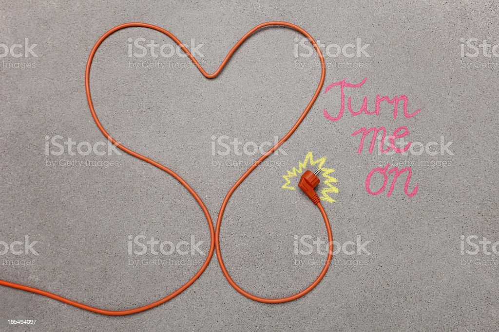 Orange electrical plugin cable in shape of a heart royalty-free stock photo
