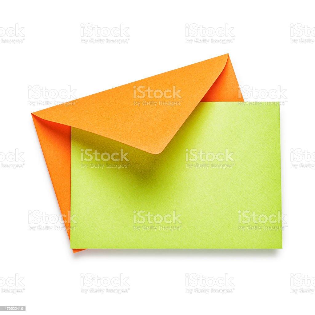Orange envelope with green card stock photo