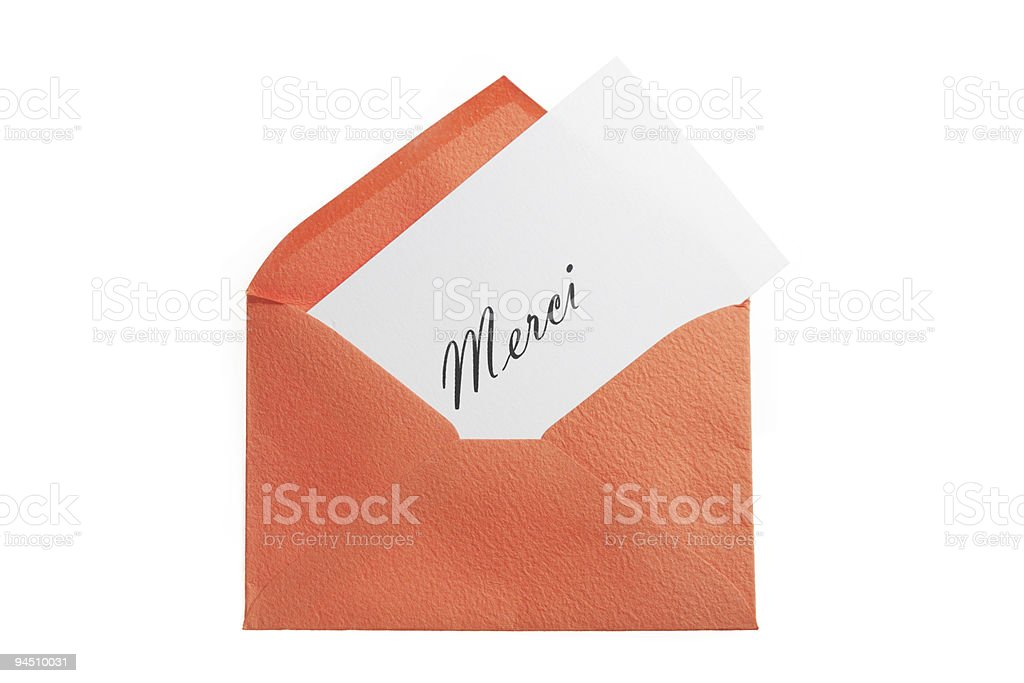 orange envelope with thanks note in french stock photo