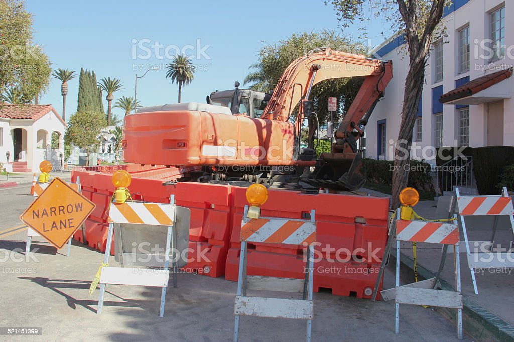 Orange Excavator at Construction Site stock photo