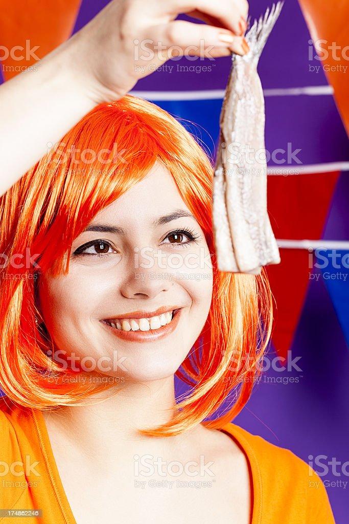 Orange fan eating herring stock photo