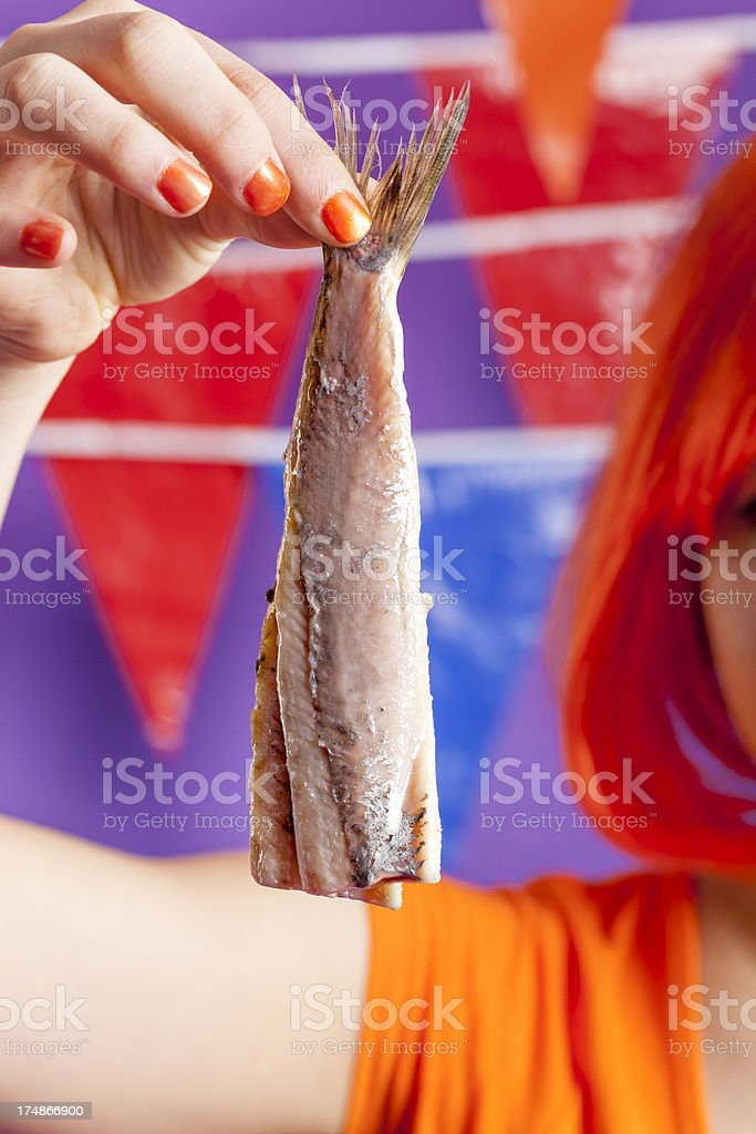 Orange fan eating herring stock photo