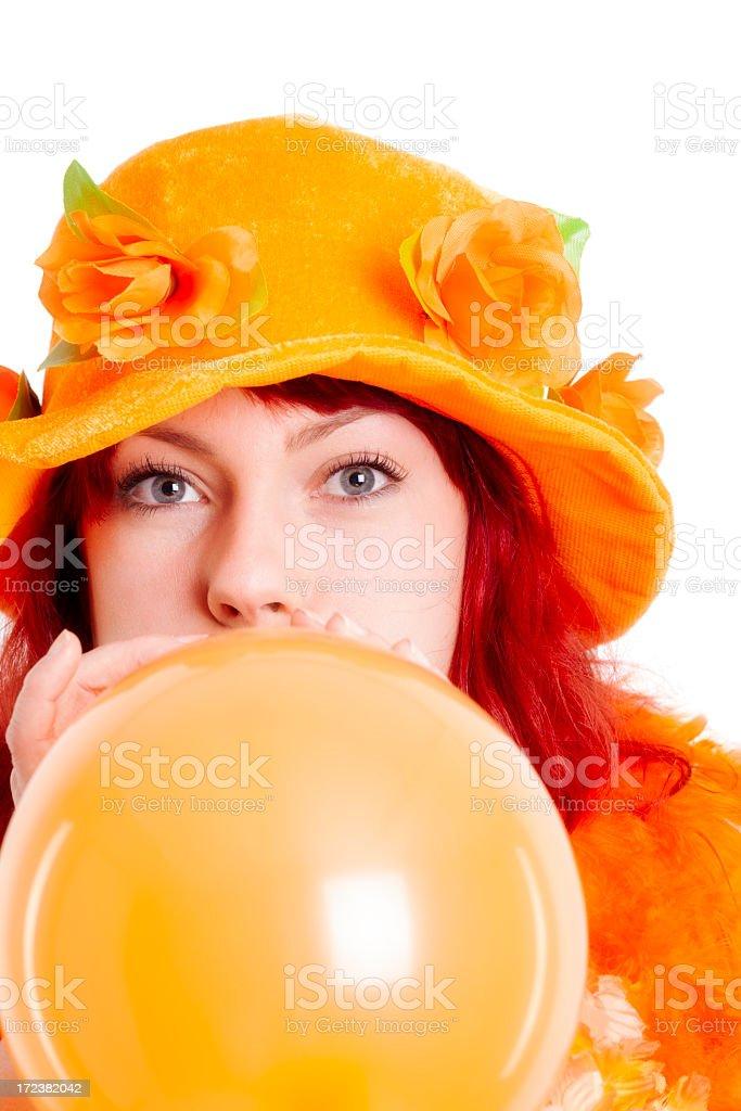 Orange fan inflating balloon stock photo