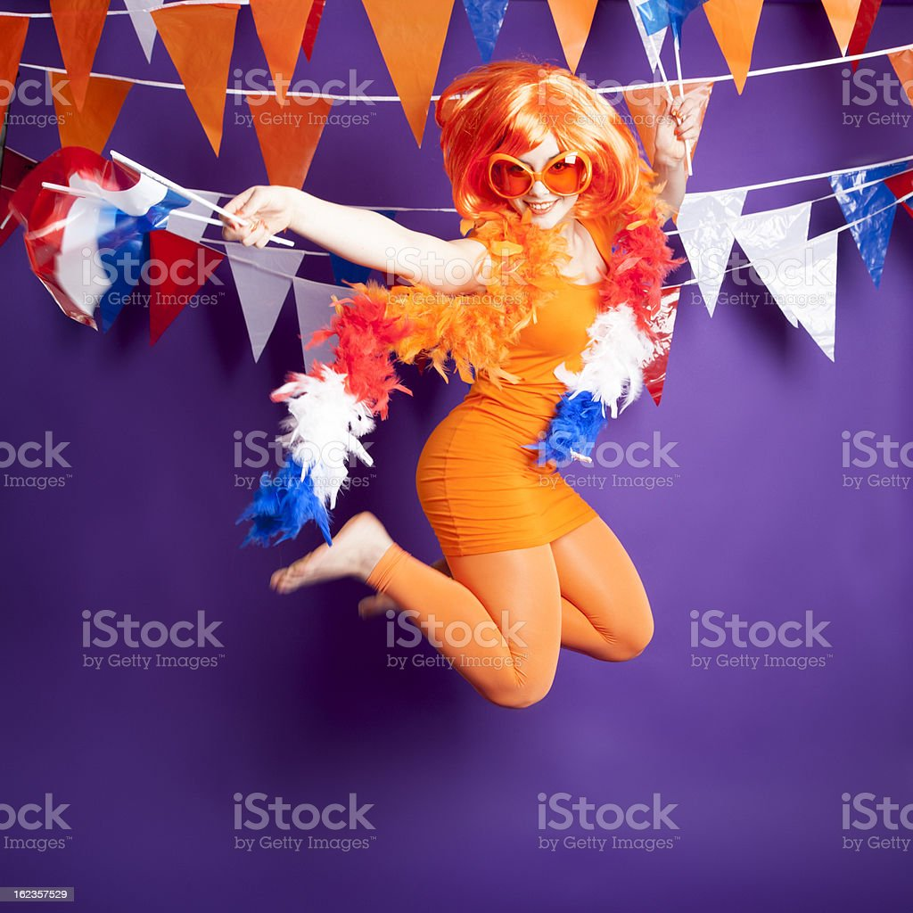 Orange fan jumping stock photo