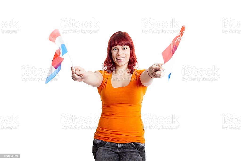 Orange fan waving Dutch flags stock photo