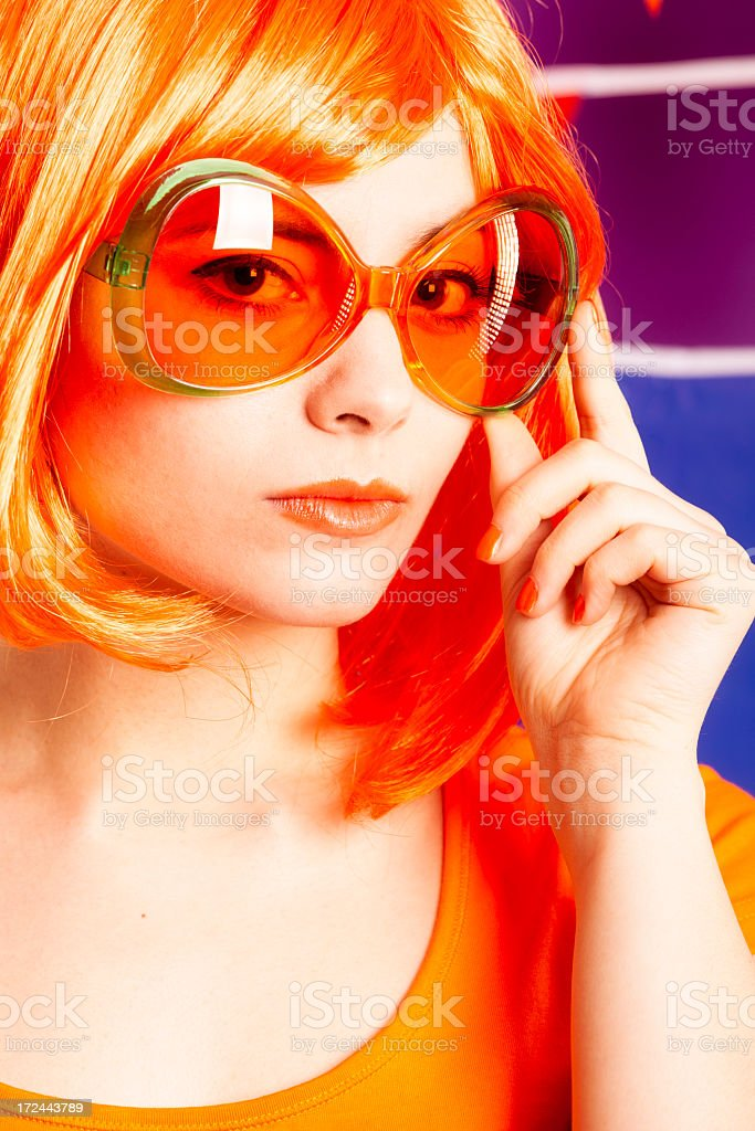 Orange fan with sunglasses stock photo