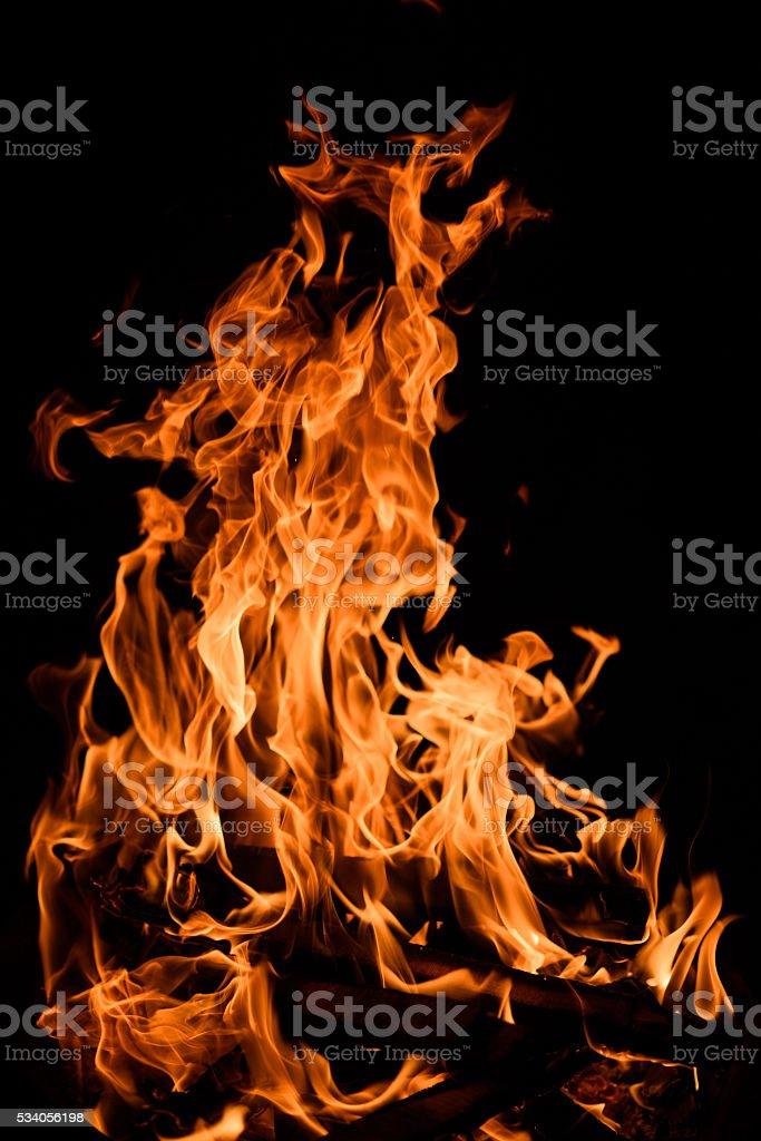 Orange fire flames isolated on black background stock photo