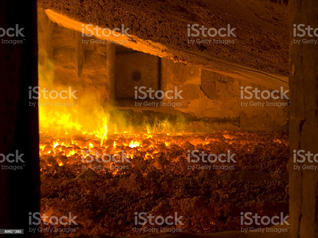 Orange fire in blast furnace in power factory stock photo