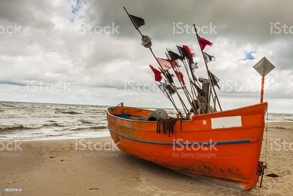 Orange fishing boast - Rewal, Poland. stock photo