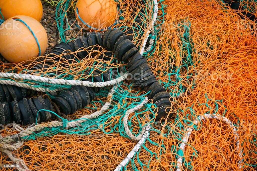 Orange fishing nets with floats stock photo