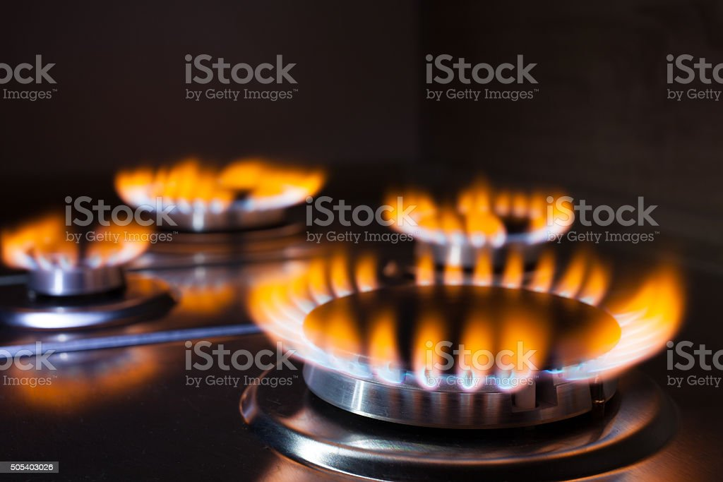 Orange flame at gas stove stock photo