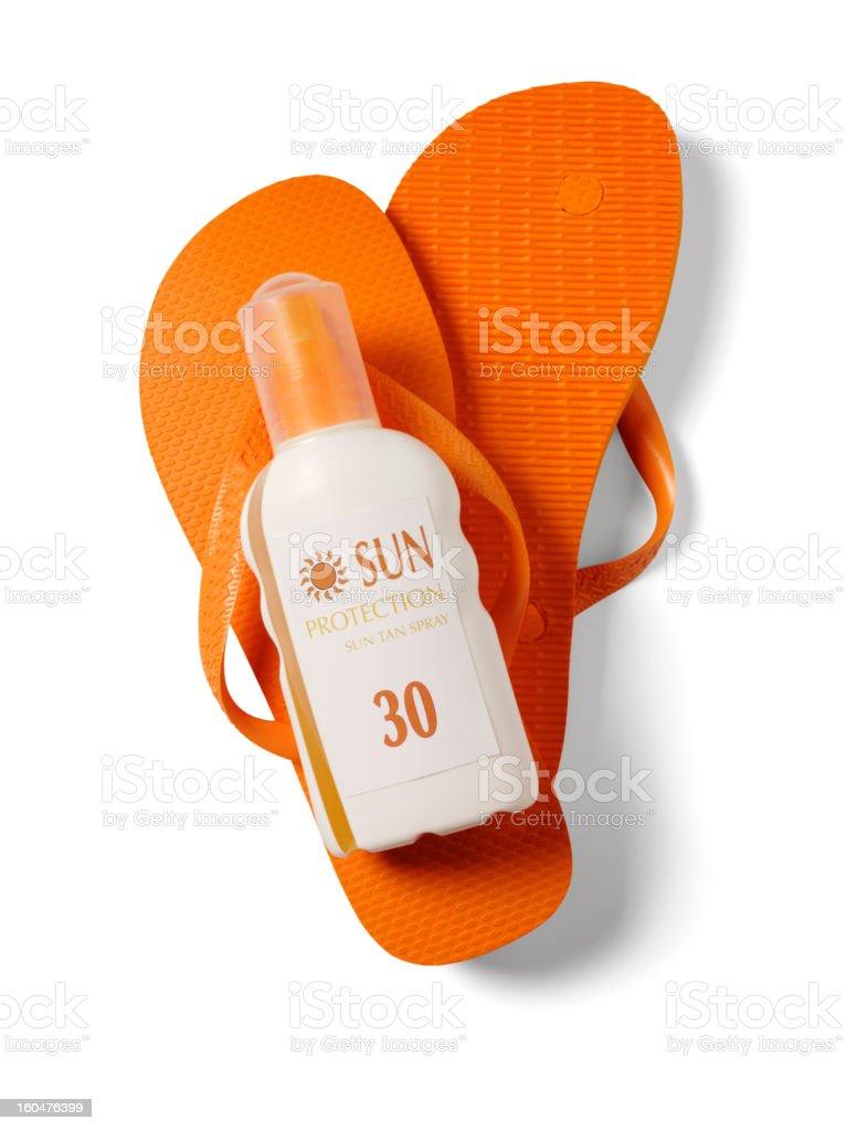 Orange Flip Flops and Sun Cream stock photo