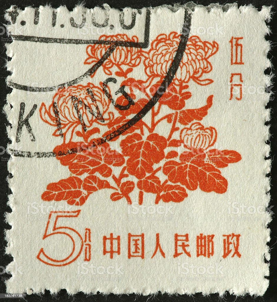 orange flowers on a Chinese stamp stock photo