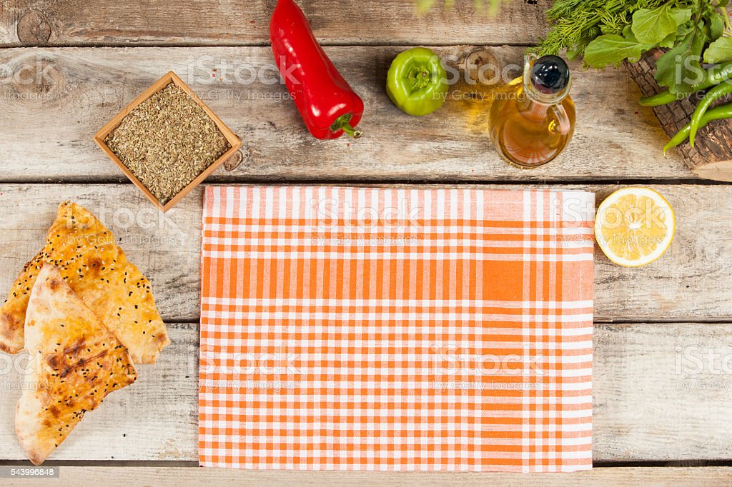 orange folded tablecloth over bleached wooden table stock photo