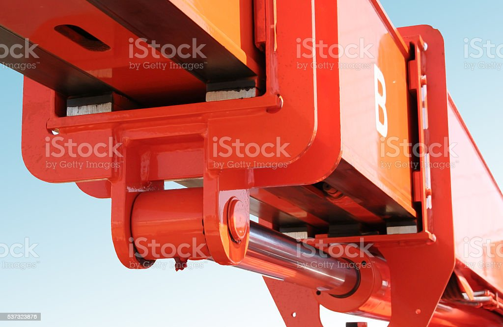 Orange forklift boom and hydraulic stock photo