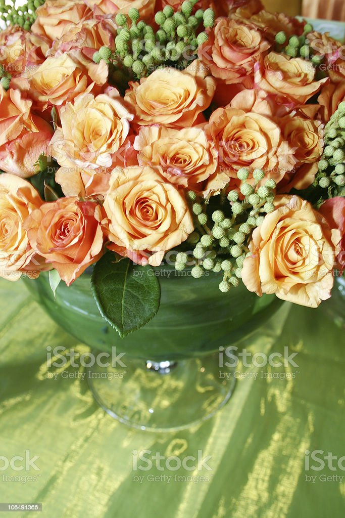 orange fresh rose bunch against green at a wedding royalty-free stock photo