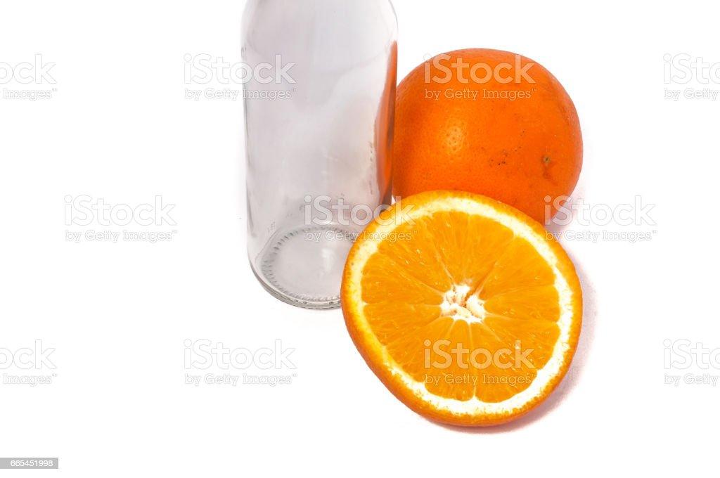 Orange fruit and empty bottle isolated on white background stock photo