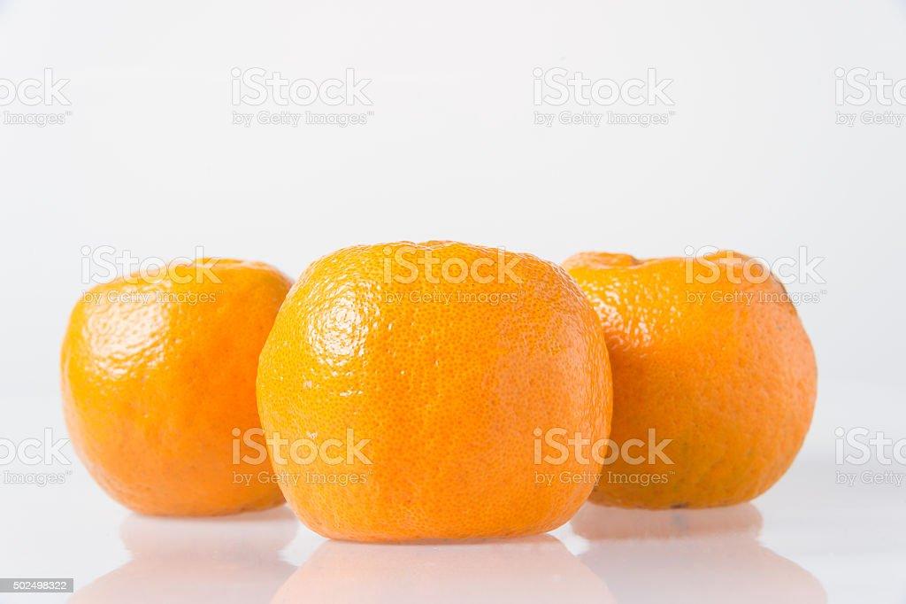 Orange fruit on white background. stock photo