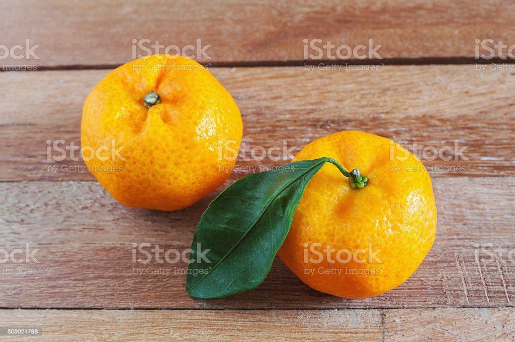 Orange fruit on wooden table stock photo