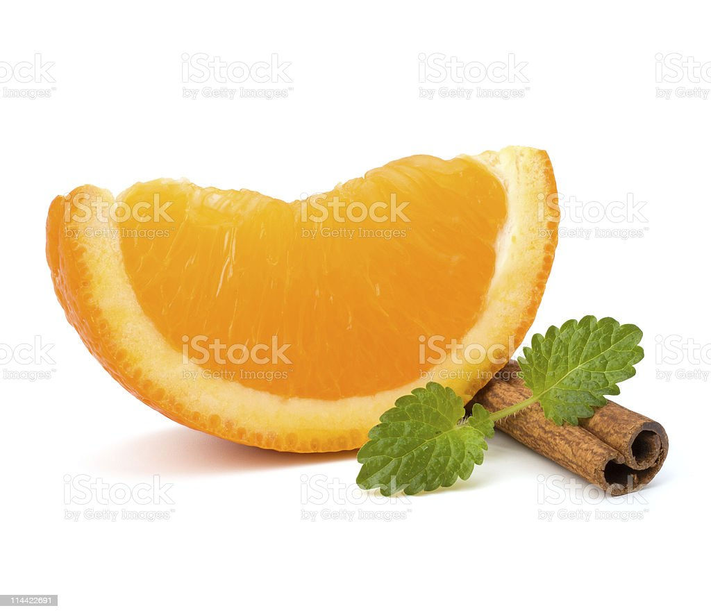 Orange fruit part, cinnamon stick and green mint royalty-free stock photo