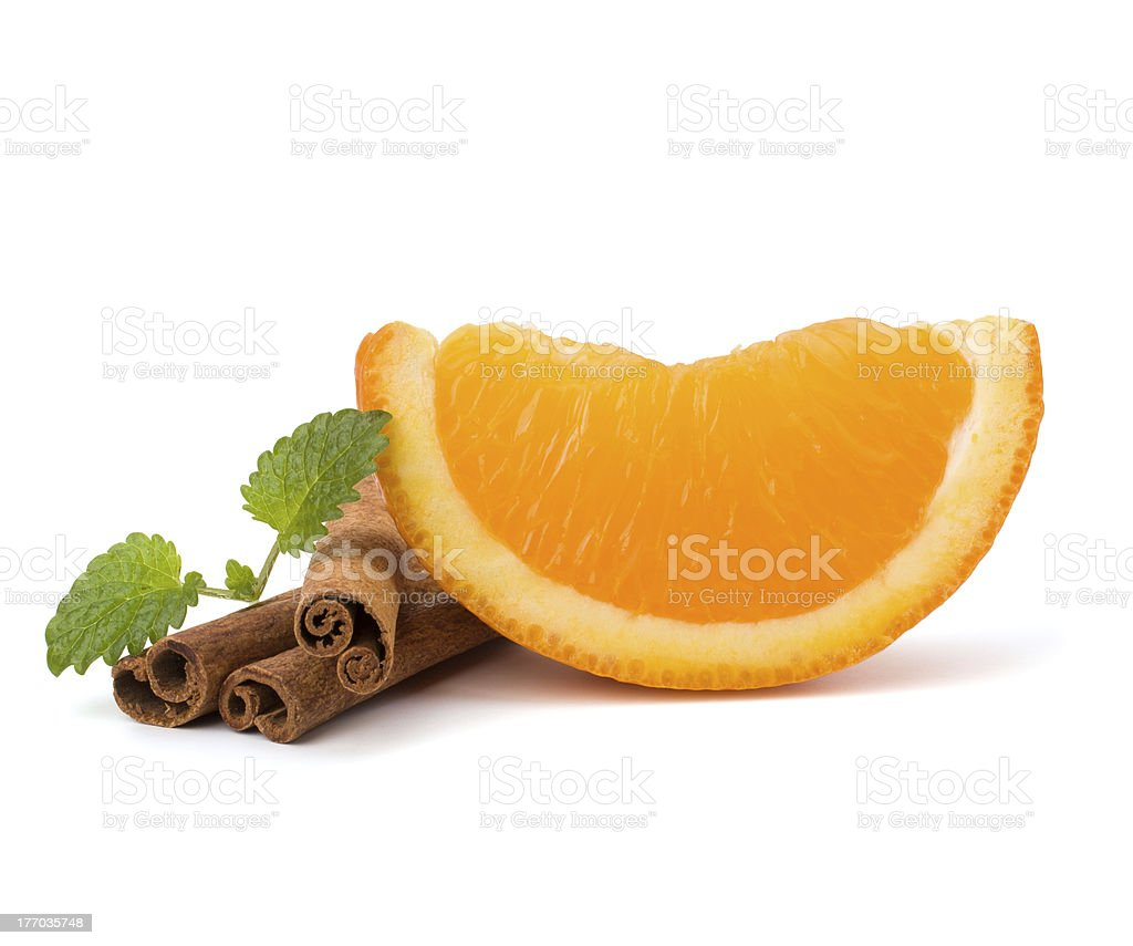 Orange fruit segment and  cinnamon sticks royalty-free stock photo