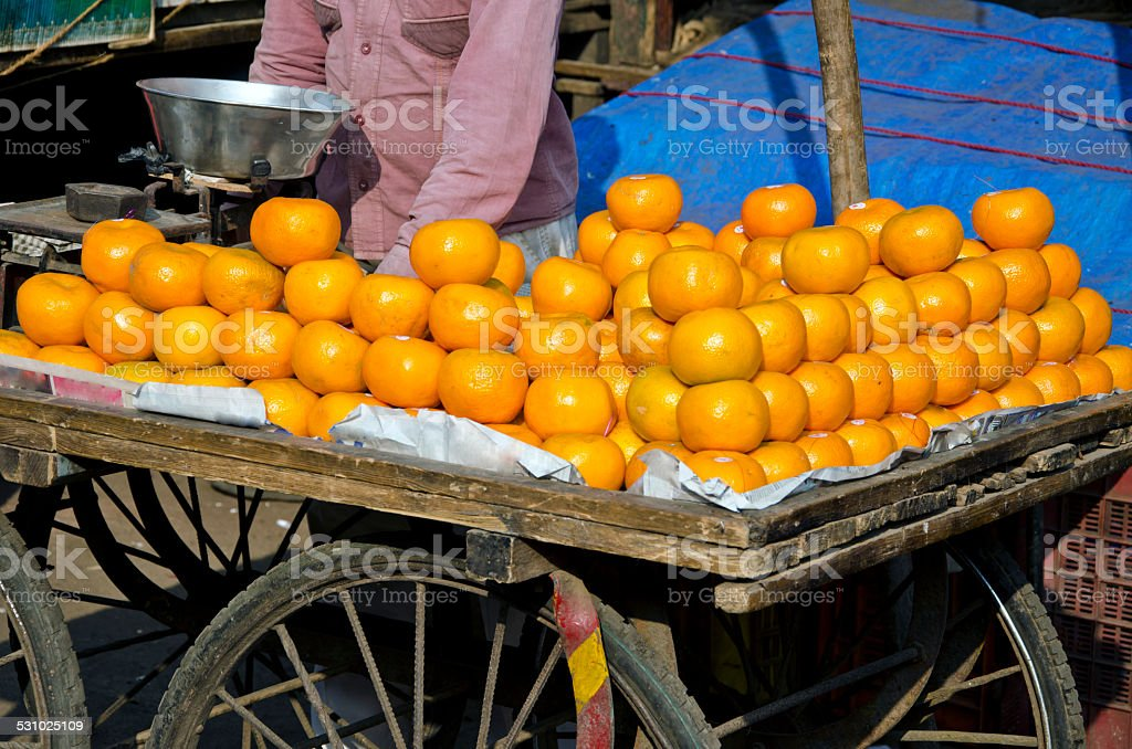 orange fruits in asia street market, India stock photo