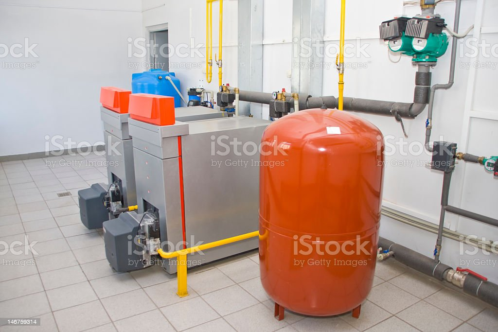 Orange Gas boiler in a gas room royalty-free stock photo