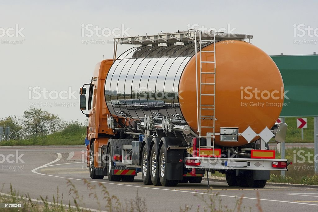 Orange gas freight truck on empty road royalty-free stock photo