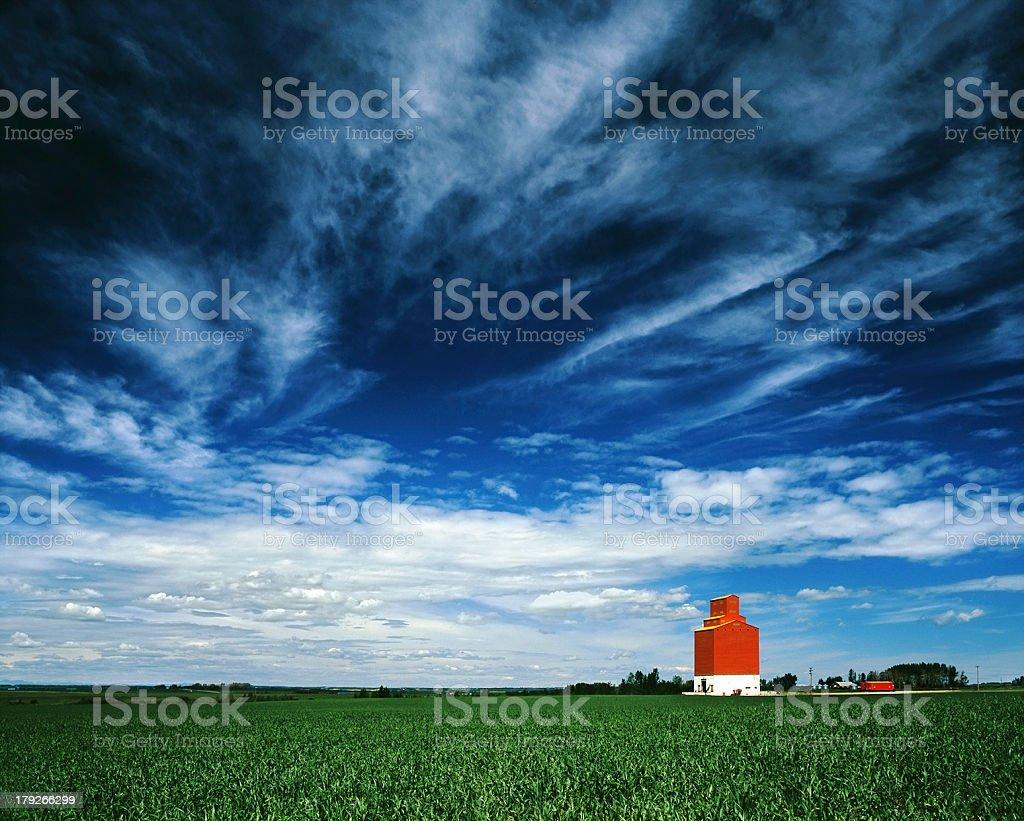 Orange grain elevator against a big blue sky. royalty-free stock photo
