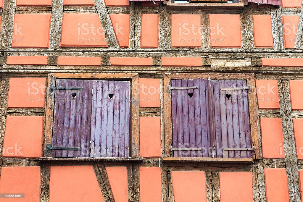 Orange half-timbered house with with wooden shutters in Strasbourg stock photo