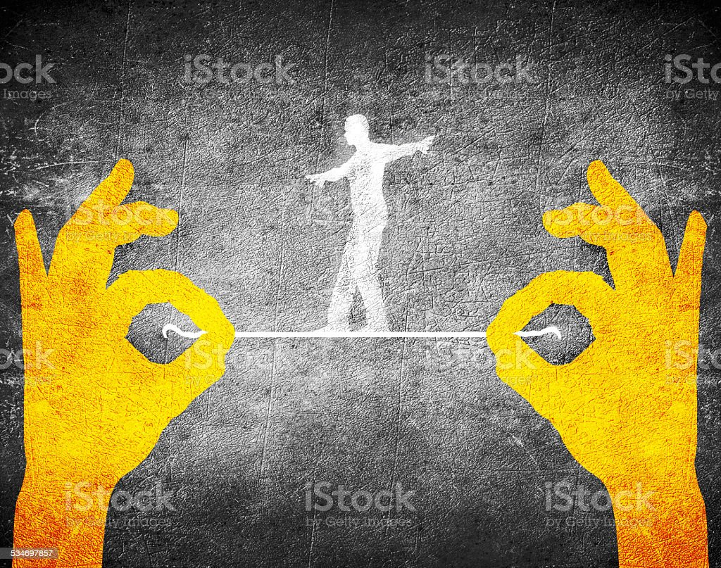 orange hands and tightrope walker stock photo