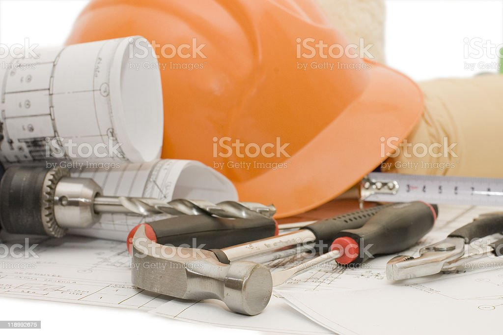 Orange helmet on the house project royalty-free stock photo