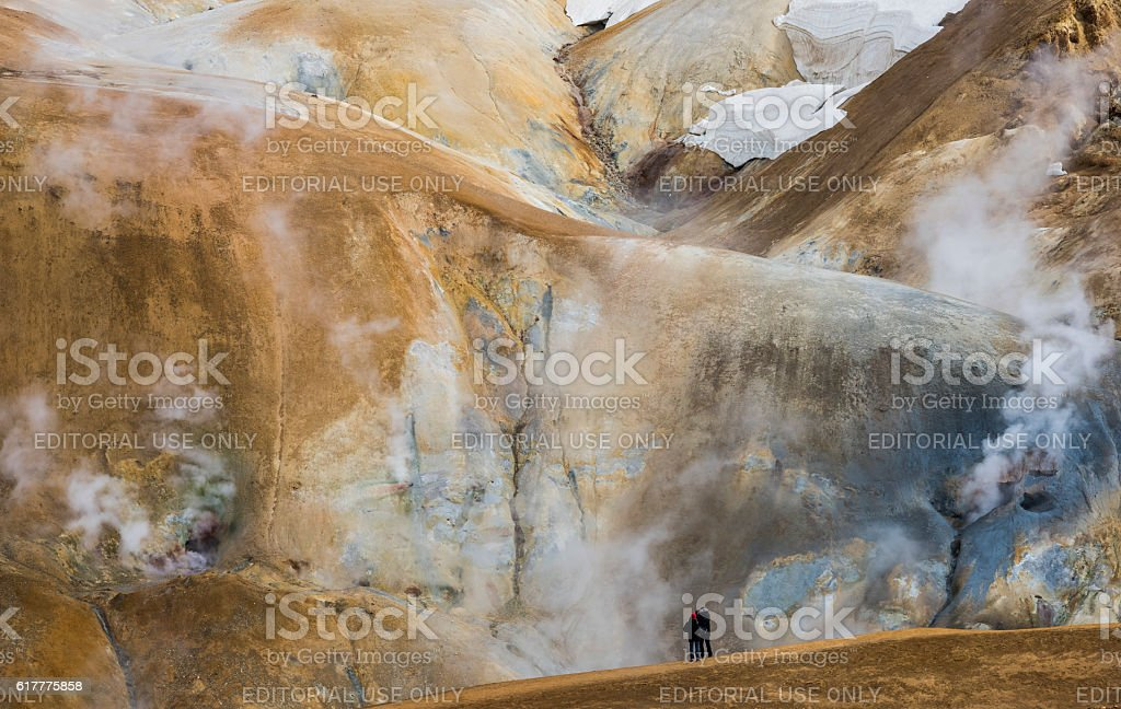 Orange Hills with Hot Steam and tourists in Kerlingarfjoll stock photo