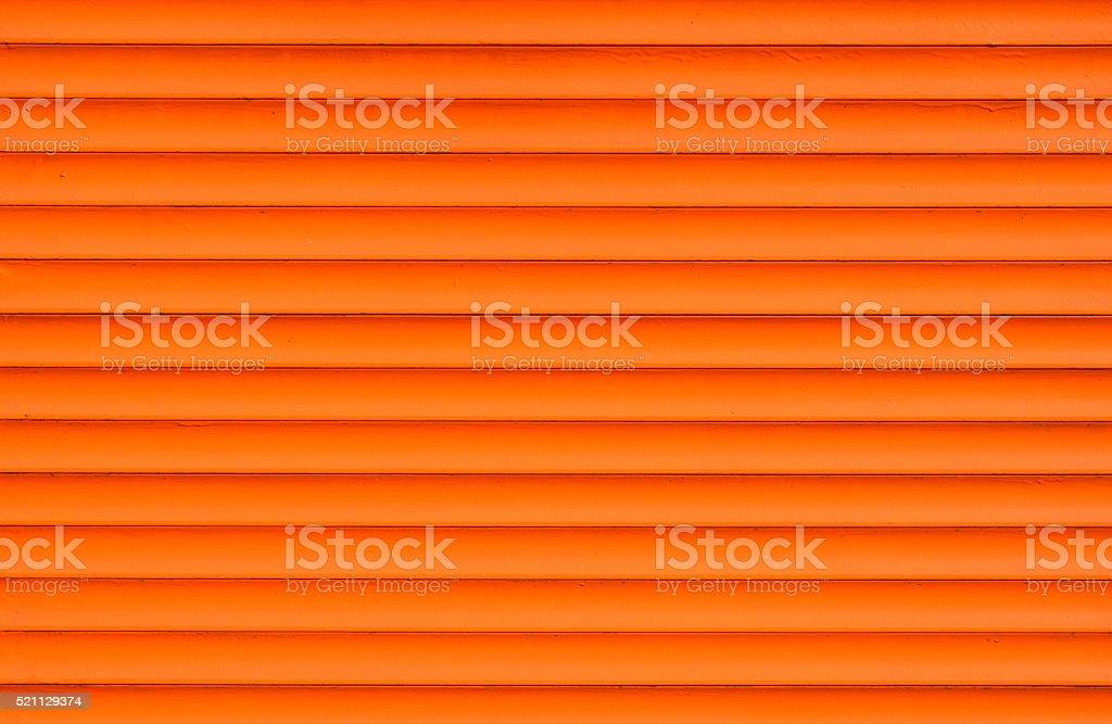 Orange horizontal roller shutter blinds royalty-free stock photo