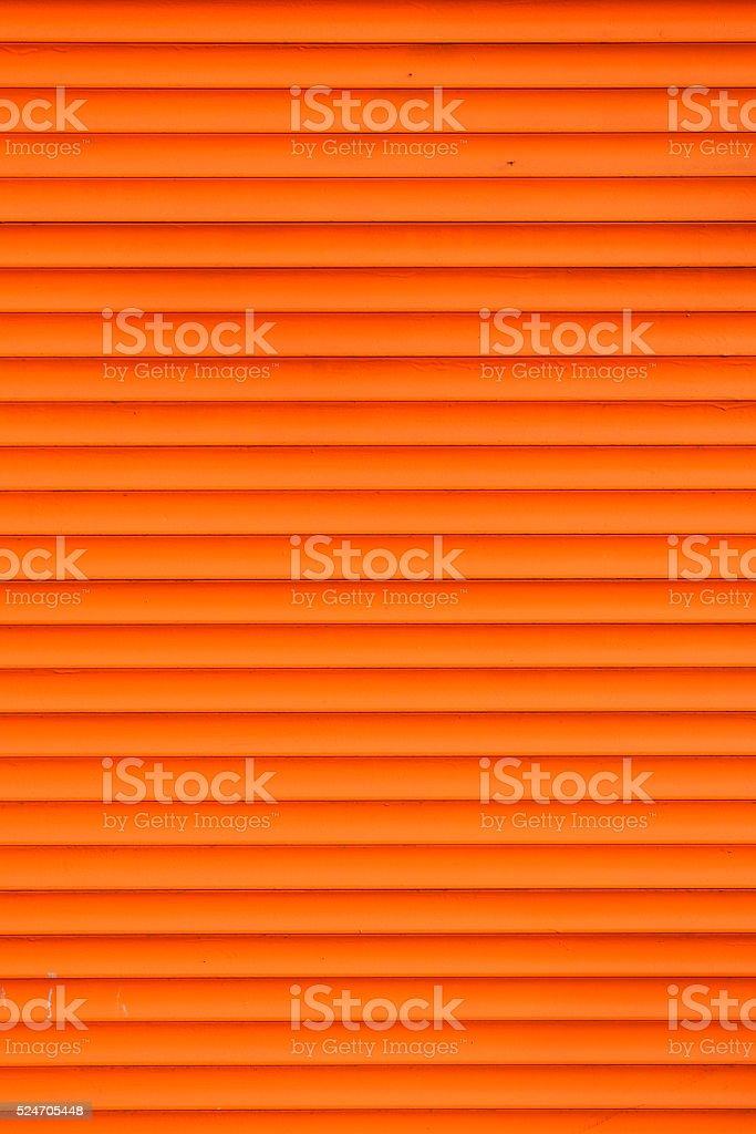 Orange horizontal roller shutter blinds stock photo