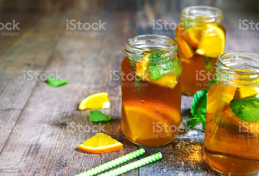 Orange iced tea in a glass jar. stock photo