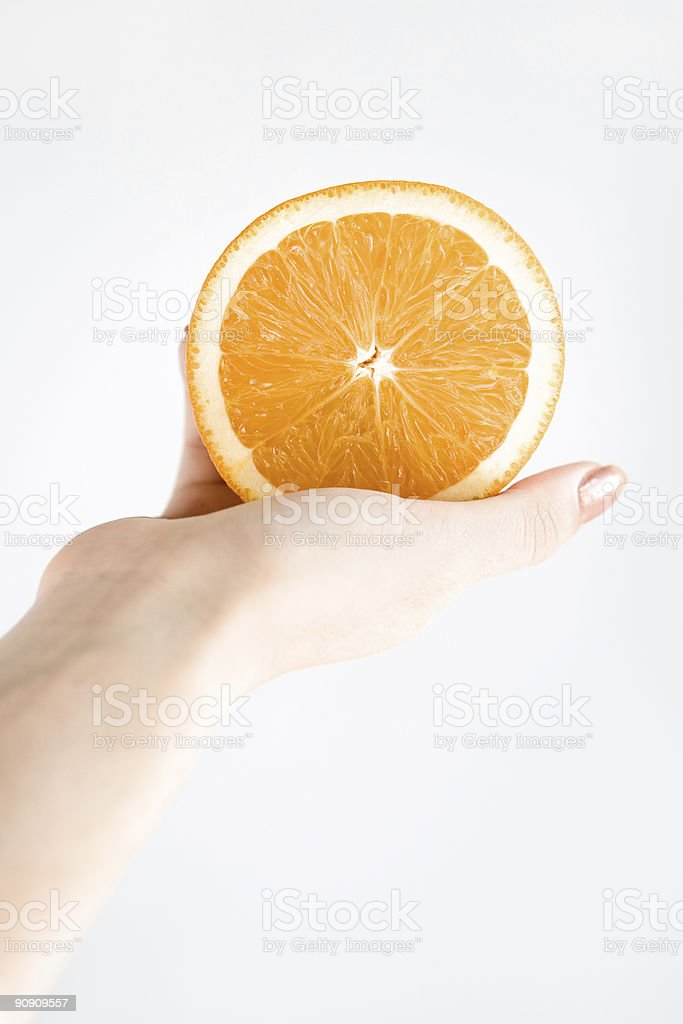 Orange in hand royalty-free stock photo