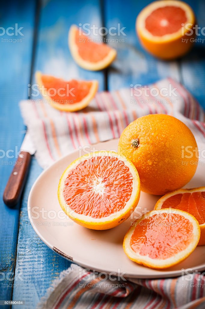 orange isolated on blue background stock photo