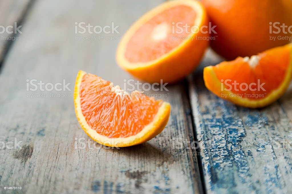 orange isolated on wood background stock photo