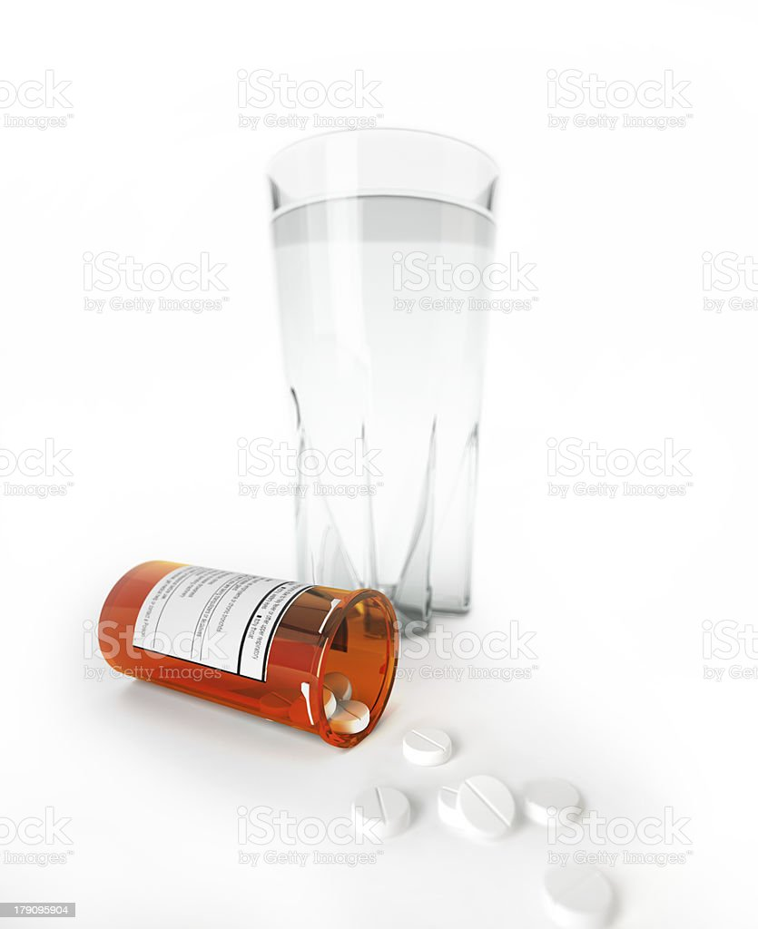 Orange jar of medicine pills lying on the table. royalty-free stock photo